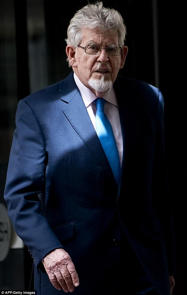 "Harassment: Rhonda went on to detail her experiences of abuse at the hands of entertainer Rolf Harris [pictured], saying: 'I had the old touch up the a*se [when I was performing in Hot Shoe Shuffle in 1992]. It's a funny thing. Now, you'd say, ""No!"" - back then, there was no excuse for you to not accept it'"