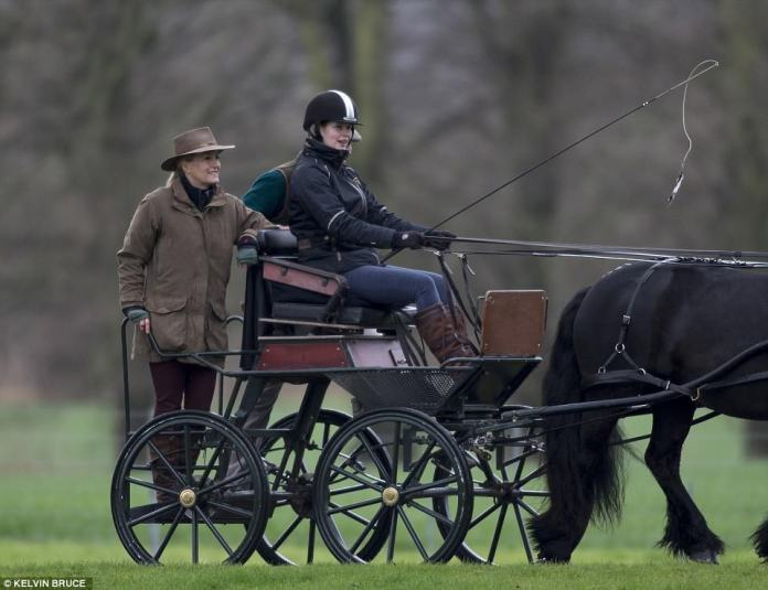 Lady Louise Windsor, 14, beamed and laughed with her mother as she drove a carriage through the grounds