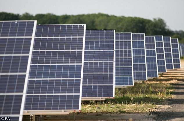 Solar panels at Kencot Hill solar farm in Lechlade, England. Britain's biggest solar farms receive more cash from green subsidies than from selling the electricity they produce