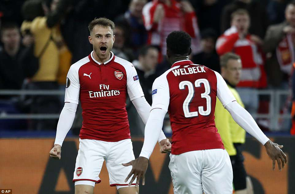 Aaron Ramsey celebrates his injury-time strike with Danny Welbeck as Arsenal survived an almighty scare in Moscow