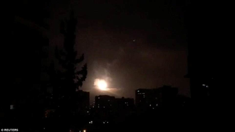 Syria air defenses strike back after air strikes by U.S., British and French forces in Damascus