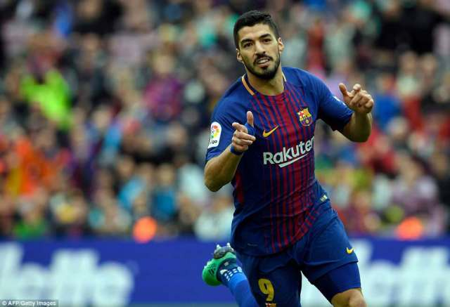 Suarez is delighted after his finish opened the scoring for Barcelona against Valencia