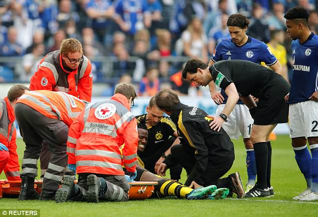 The Belgian was treated on the field by medical staff, while fellow players looked concerned