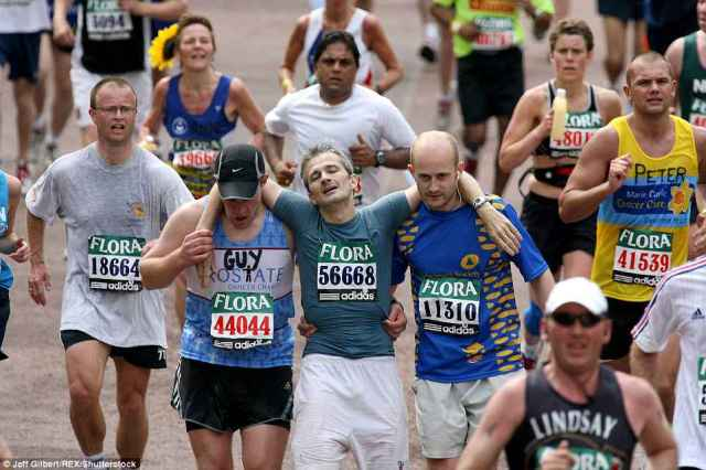 The hottest London marathons on record took place in both 1996 and 2007 when temperatures hit 22.2C - leading to hundreds of runners collapsing (pictured, a runner being helped to the finished line in 2007)
