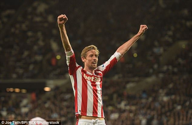 Crouch celebrates his goal – but West Ham equalised late on to dent Stoke's survival hopes