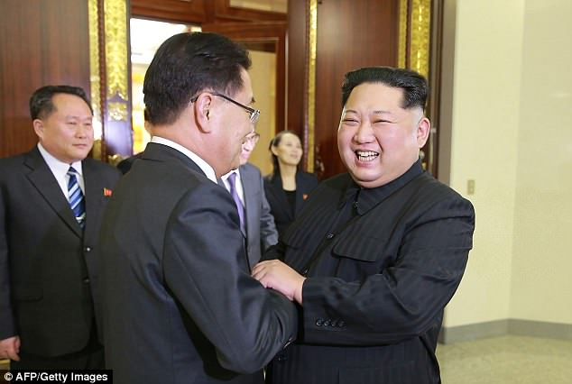 The comments came after US President Donald Trump said the summit between North Korean leader Kim Jong Un and the South's President Moon Jae-in could include a discussion about a peace treaty. Pictured: Kim meeting South Korean chief delegator Chung Eui-yong on March 5 during a meeting to defuse tensions between the Koreas