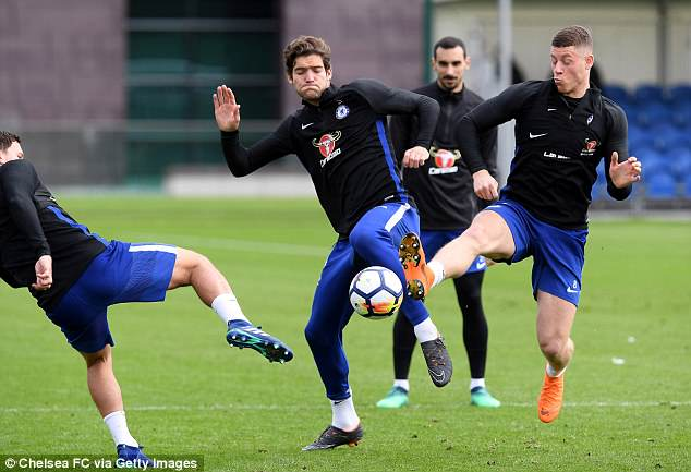 Marcos Alonso (centre) battles for the ball with England international Ross Barkley