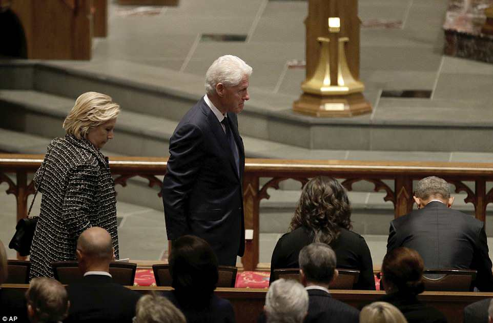 Familiar faces: Bill and Hillary Clinton followed the Obamas into the service and were not seen  chatting with Melania