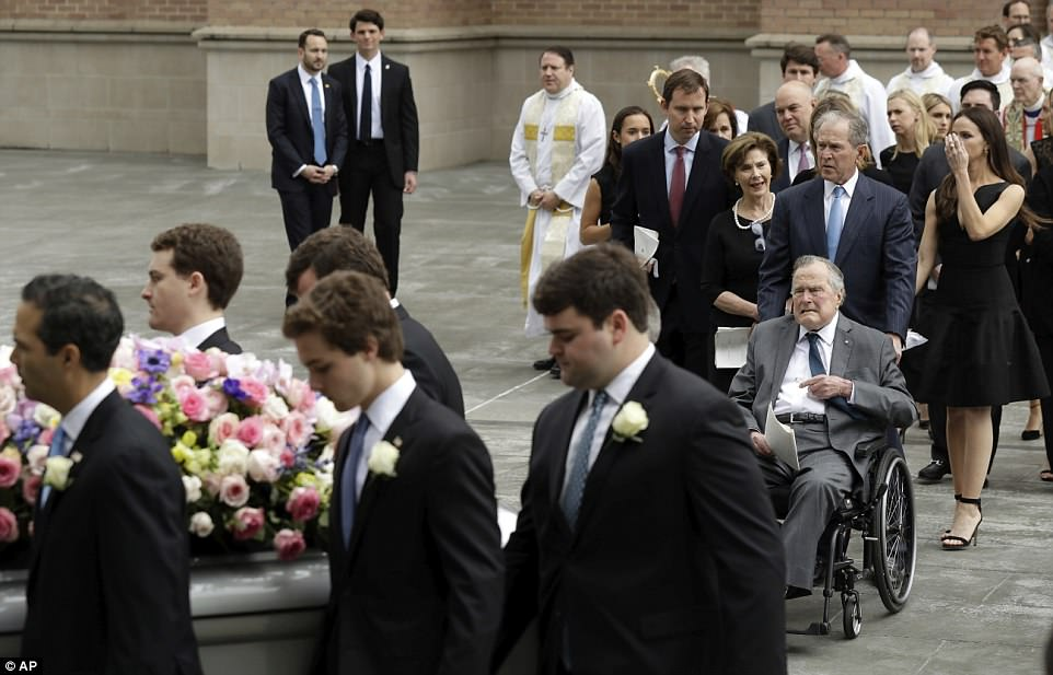 Final farewell: The Bush family says goodbye as the family matriarch is taken from the church and headed to her burial plot