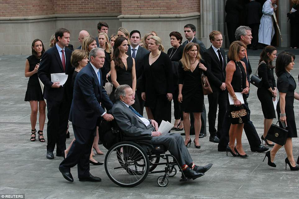 Bush clan: The family exits the church after watching the hearse drive off with Mrs. Bush's casket
