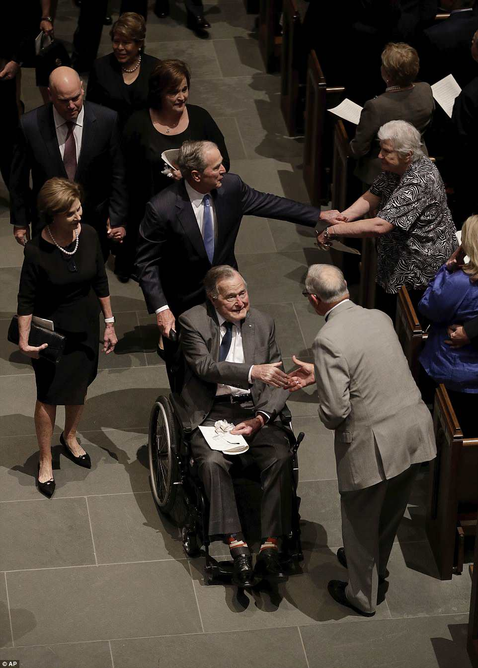 George H.W. Bush shook hands with mourners as he led the family after the service