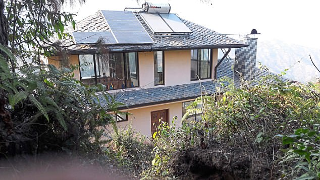 Dalglish had a 30-year career with the UN and was arrested at his house in Nepal (pictured)