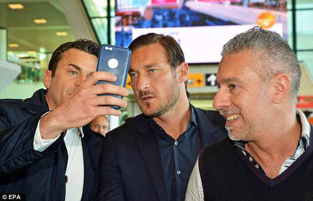 Club legend and director of sport Francesco Totti also travelled, and was mobbed by fans