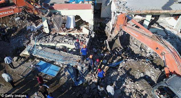 Earthquake: Members of Turkish Prime Ministry's Disaster and Emergency Management Authority (AFAD), carry out rescue works in the wreckage of a two-storey building which partially collapsed in the 5.2 magnitude earthquake on Tuesday morning