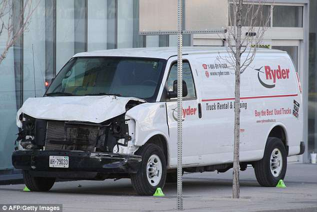 The front end damage of the van that the driver used to hit several pedestrians in Toronto, Ontario, on Monday, killing 10