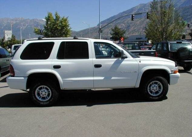 Police say Korf is driving the pair in a white 1999Dodge Durango (file image of the same car shown above)