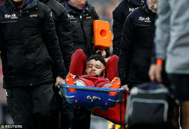 The former Arsenal player was taken off the Anfield pitch on a stretcher on Tuesday night