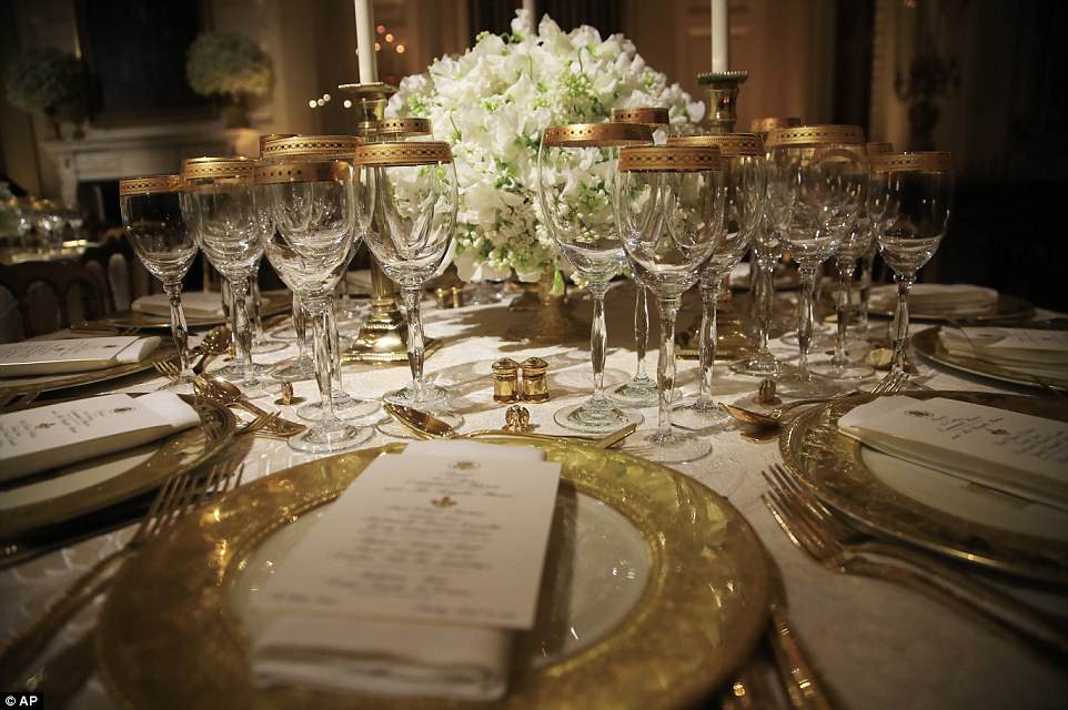 "Mrs. Trump chose Clinton china services to coordinate with the dinner's cream and gold color scheme, and Bush china with a green color palette to ""compliment the spring garden and white flowers that will be featured in the State Dining Room"""