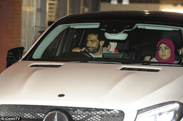 Mohamed Salah smirks as he is pictured leaving Anfield following Liverpool's win over Roma