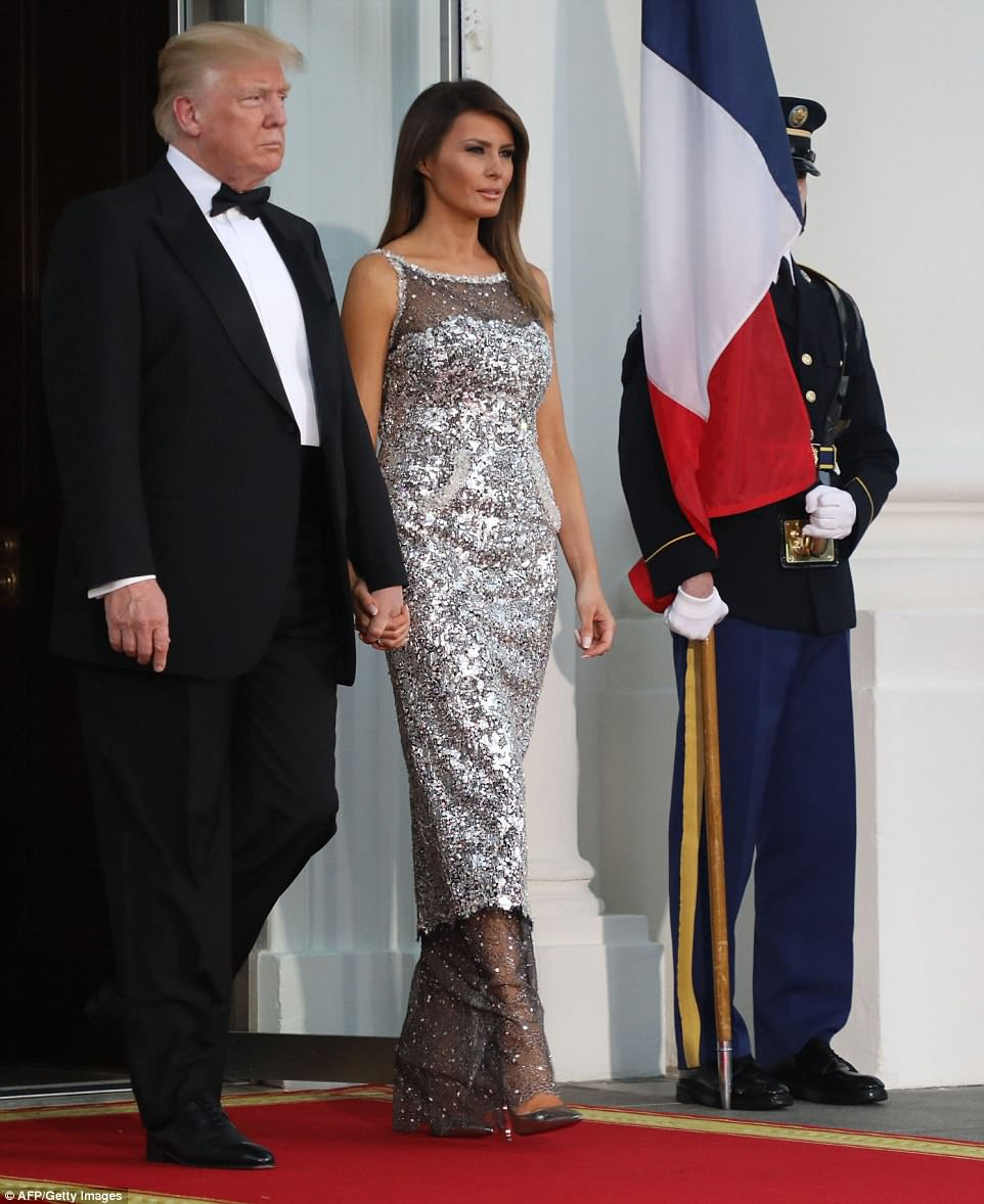 President Donald Trump and First Lady Melania held hands outside the White House on Tuesday awaiting the arrival of French President Emmanuel Macron and his wife Brigitte for the state dinner