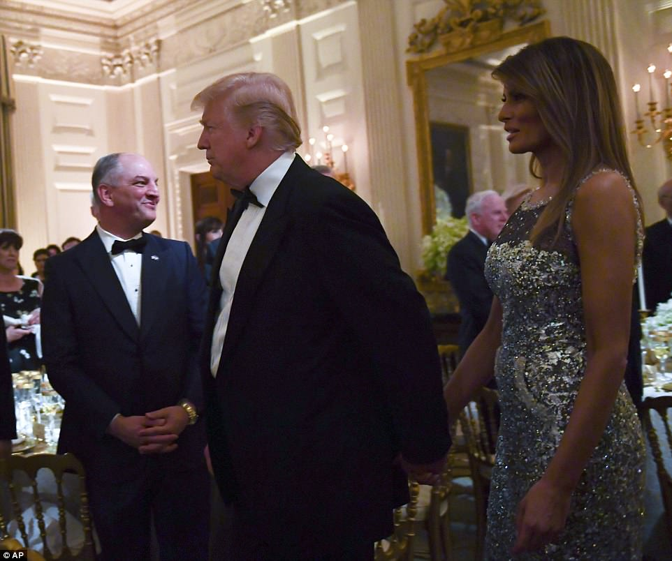 The Trumps held hands as they made their way into the state dinner on Tuesday, which Melania played a central role in planning