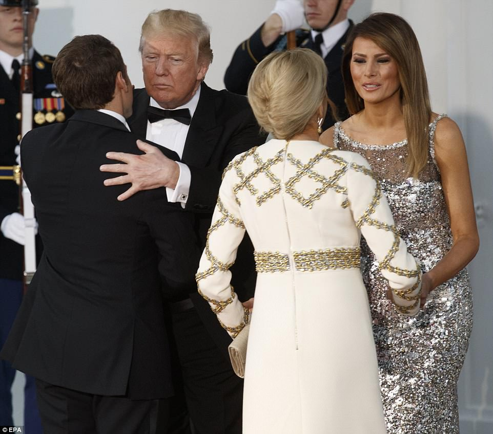 Trump and his wife, Melania, exchanged hugs and air kisses with the Macrons before going inside the White House for the festivities