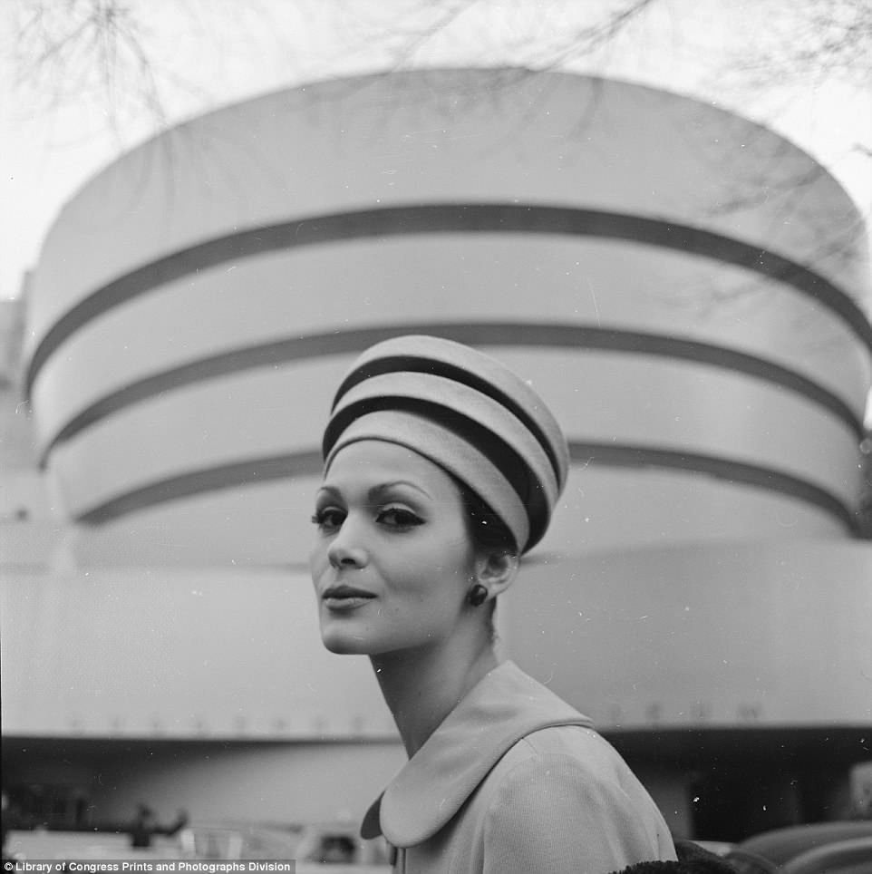 This photo was taken in 1960. It shows a woman wearing a hat whose design looks a lot like that of the building behind  her - the Guggenheim Museum in New York City