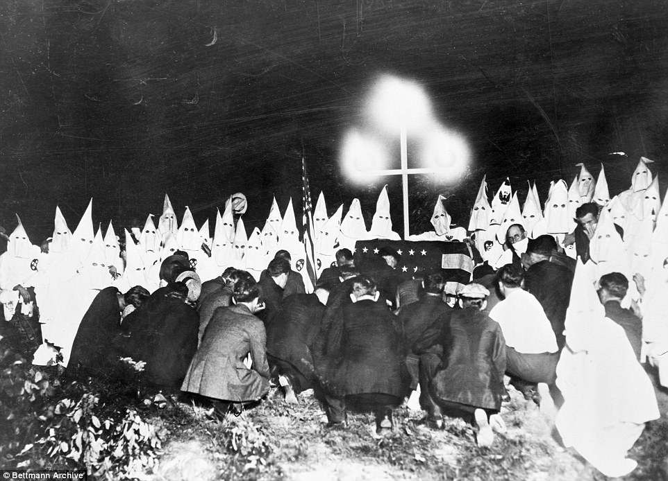 Others are menacing, like the image of a 1920s-era Ku Klux Klan rally two miles from Washington, DC, that includes a Klan member glaring at the photographer