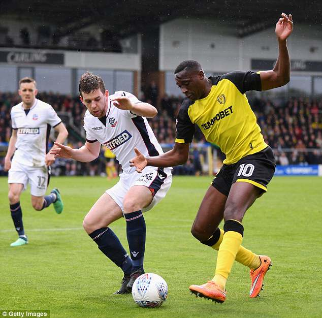 Lucas Akins of Burton Albion tries to beat Bolton's Jon Flanagan during the opening stages