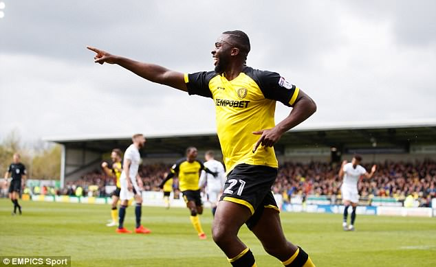Akpan runs off in celebration after scoring a crucial goal in Burton's survival effort