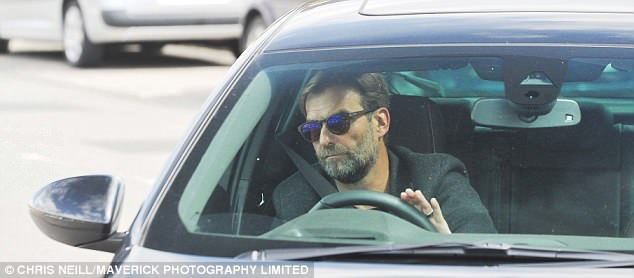 Jurgen Klopp arrived at Melwood earlier in the afternoon looking stony-faced in his car