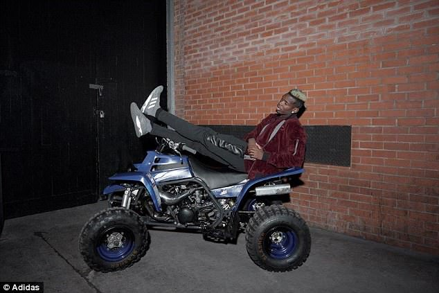 Paul Pogba lays across a quad bike in an Adidas promotional photoshoot