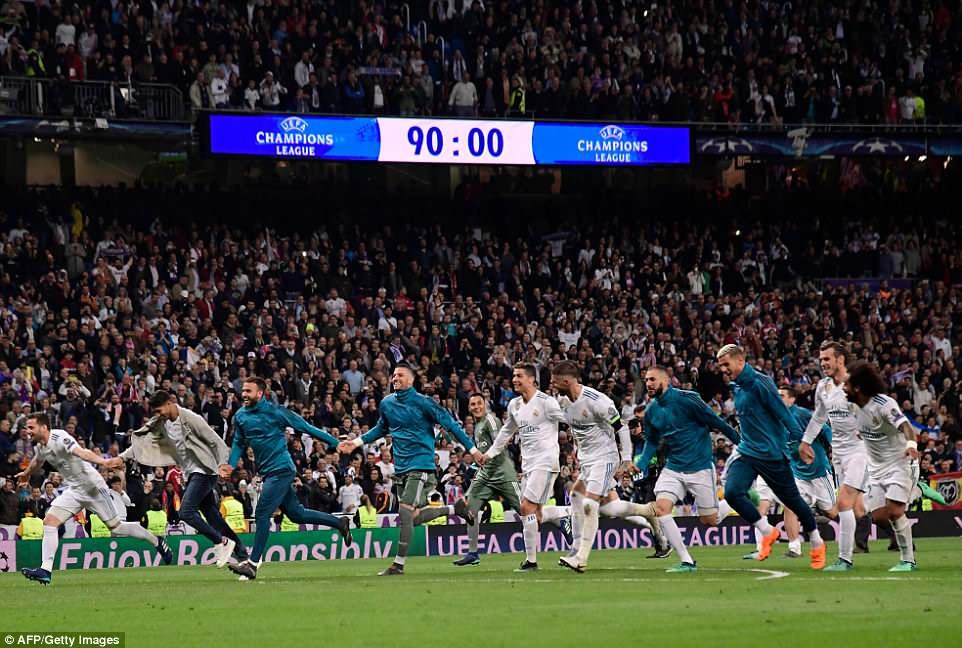 The victorious home side join hands and celebrate in front of their supporters after reaching another European final