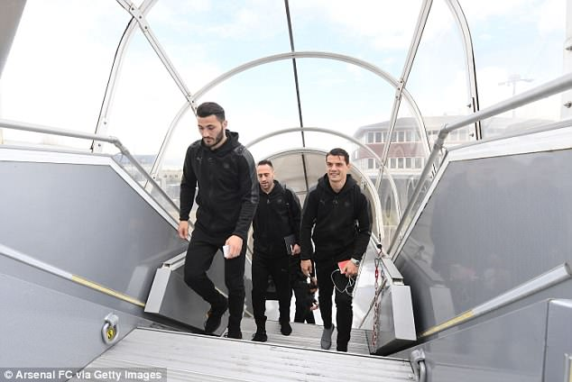 Sead Kolasinac, David Ospina and Granit Xhaka (left) board the team plane on Wednesday