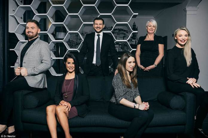 The dream team: Dr Nestor's 'super clinic' offers an abundance of services from aesthetic medicine to hair restoration, female intimate health and GP services, in an ultra-chic city centre setting (Dr Nestor is pictured centre with experts at the clinic)