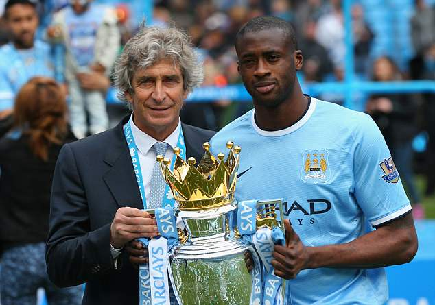 The midfielder celebrates winning the Premier League title in 2014 with Manuel Pellegrini