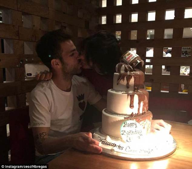 Cesc Fabregas has celebrated his birthday with a giant cake and his fiancee Danielle Semaan