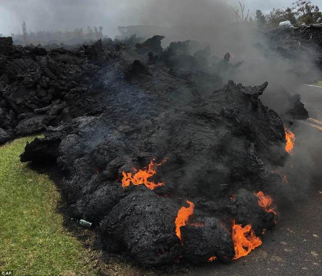 Lava burns across the road in the Leilani Estates in Pahoa, Hawaii on Saturday as residents fled from the area