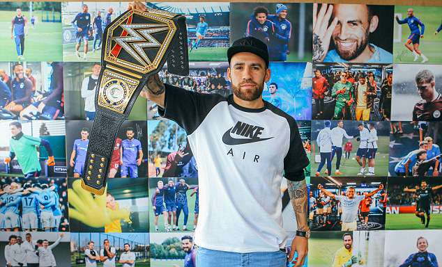 Defender Nicolas Otamendi looked like an expert as he held the WWE championship aloft