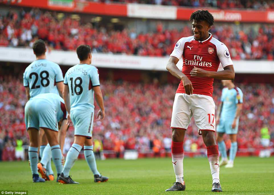 Iwobi celebrates after in front of the Arsenal supporters after bagging his third goal of the season in the 64th minute