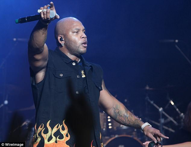 Alexis also claims that none of Flo Rida's large family – the rapper has seven sisters - have tried to build a relationship with their nephew. Flo Rida is pictured performing in June 2017