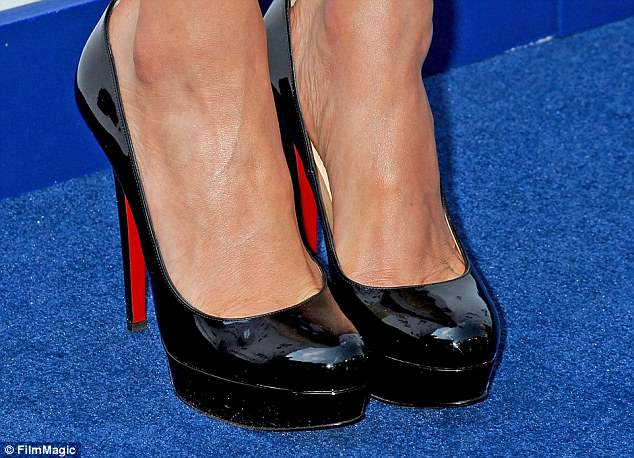 Racy: No missing Meghan in these black platform Christian Louboutins, worn at a USA Network event in May 2016