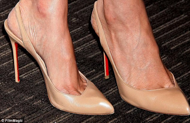 Nude: Meghan's love of Christian Louboutin's distinctive red-soled heels, worn here in New York in 2014, started while filming Suits