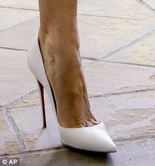 Melania's Christian Louboutin pumps feature the brand's trademark red sole and retail for $775
