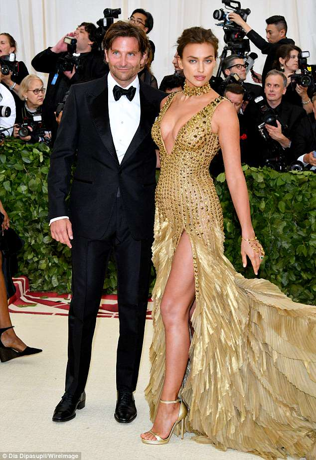 Date night: The Philadelphia-born 43-year-old sported a bit of stubble with his classic tuxedo selected by stylist Ilaria Urbinati while the Russian 32-year-old was every bit the golden girl