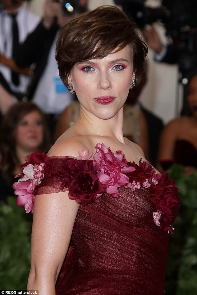 Something different: Scarlett showed off a short brunette hairstyle at the event, where she also chose to match her make-up to the colors of the dress