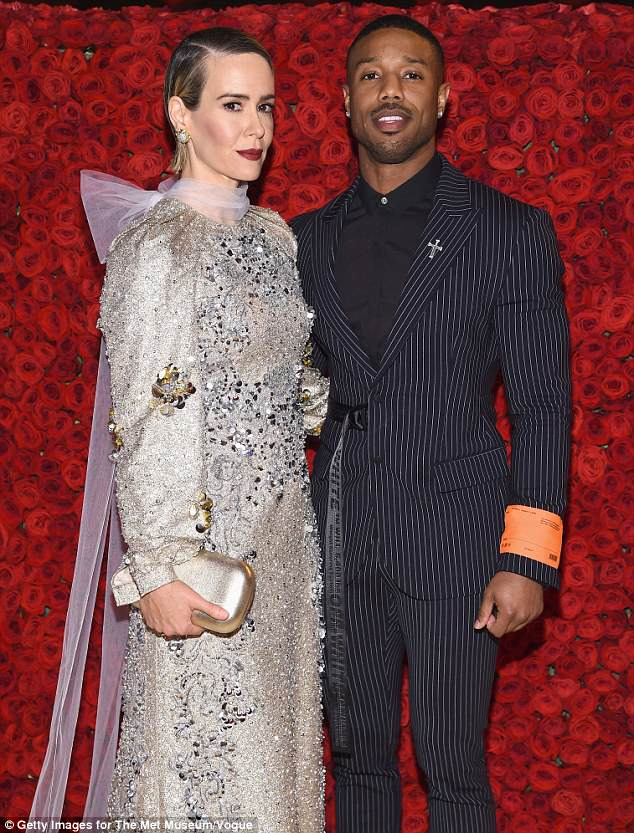 Red carpet style: Sarah Paulson shimmered in a metallic number as she posed alongside Michael B. Jordan