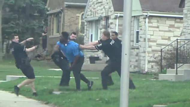 A video of the brawl between the officers and Lowe on a street in a northern Milwaukee neighborhood has gone viral on social media