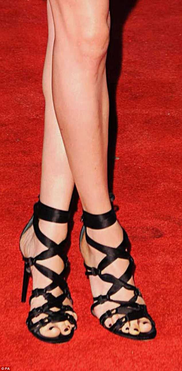 Making a statement: Strappy ribbon heels at the UK premiere of The Hunger Games: Catching Fire in November 2013