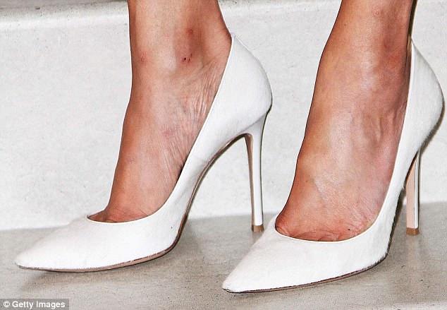 Fashionably white: Statement stilettos at a party hosted by American designer Diane von Furstenberg in New York, July 2013